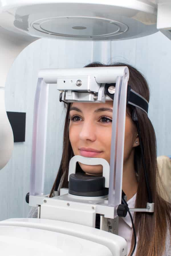 female patient being examined on digital x-ray machine