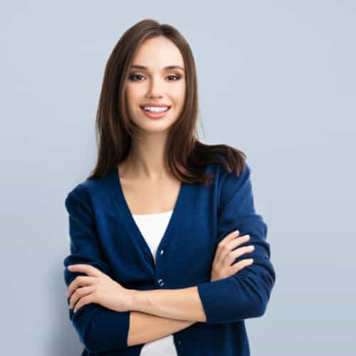 business woman with arms crossed on isolated background