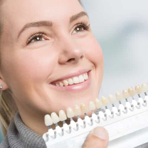 female receiving veneer consultation